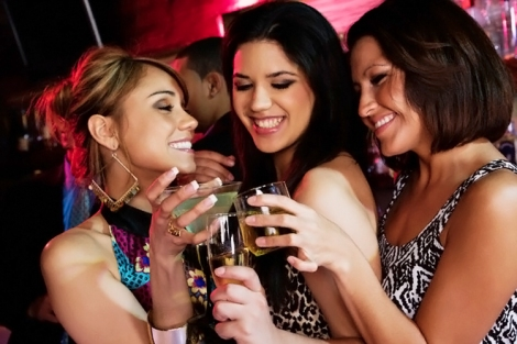 Group of women drinking cocktails nightclub
