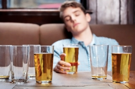 Young man asleep in bar