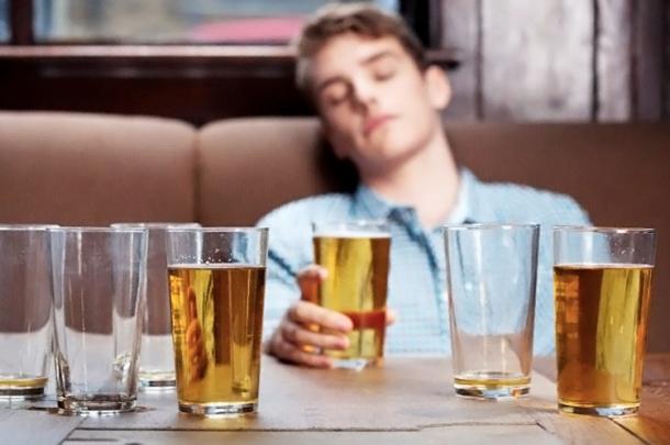 Young man asleep in bar