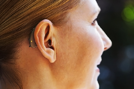 Close-up Of Woman's Ear with Hearing Aid
