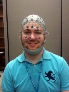 Joel is wearing an EEG cap.
